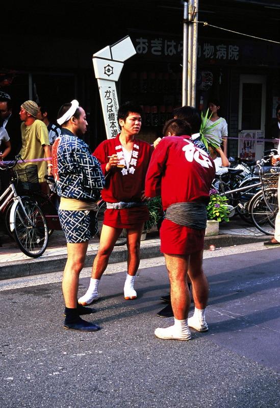 Men standing around in costume