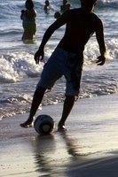 Beach Shadows - boys and footballs