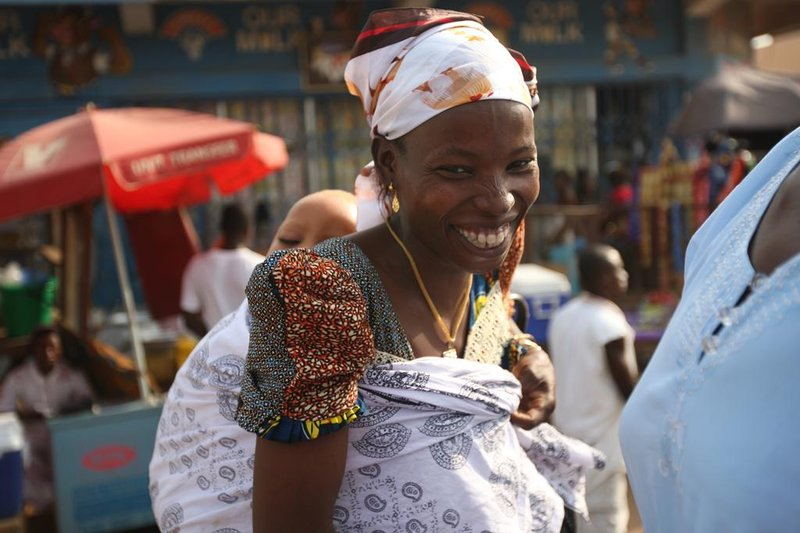 Smiling Woman in the Market