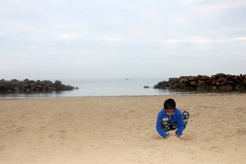 Kid playing in the private beach