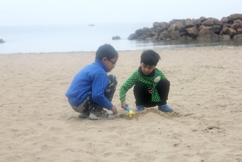 Tarun and Varsha Playing in the beach