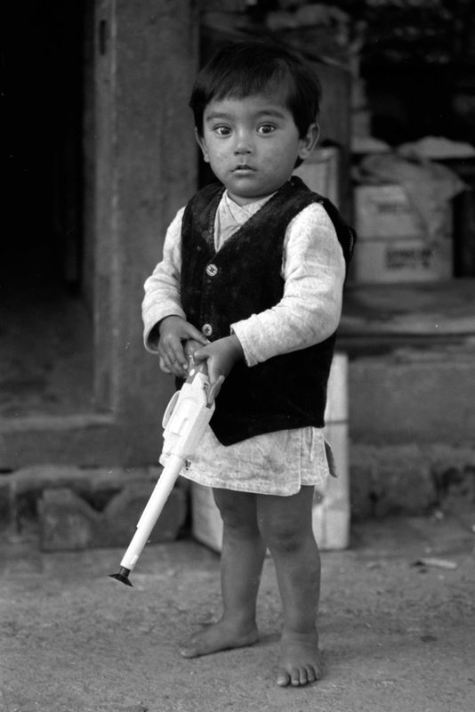 Child with toy gun