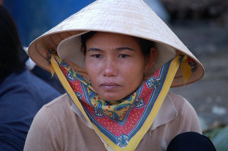 Woman in fish market, Hue