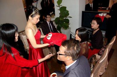 Engagement, the bride serving tea