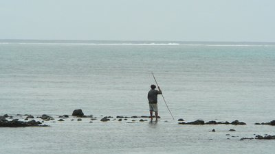15. Fisherman on Vuna reef