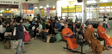 Monks share the waiting, Chiang Mai bus terminal