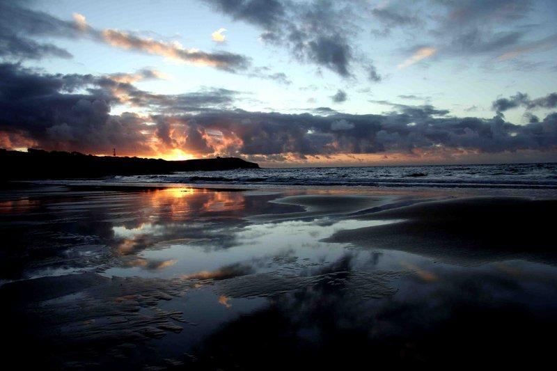 T Back beach sunset Devonport
