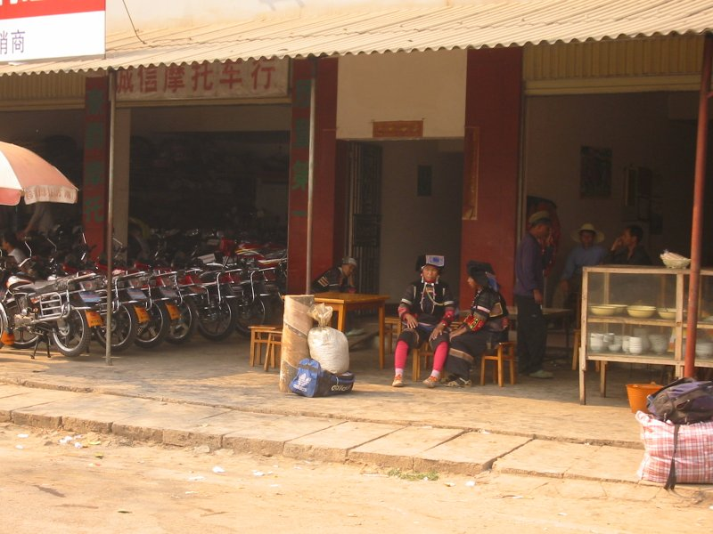 Minority Women Hanging out at the Motorbike shop