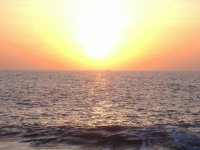 sunset at palolem beach plus fisherboat