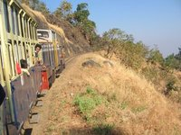 The narrow gauge toy train climbing up the hills to reach Matheran