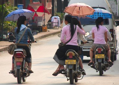Elegant scooterists in Luang Prabang