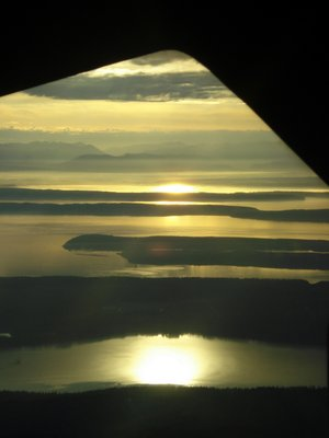 Sunrise from a small commuter plane Port Angeles to Seattle