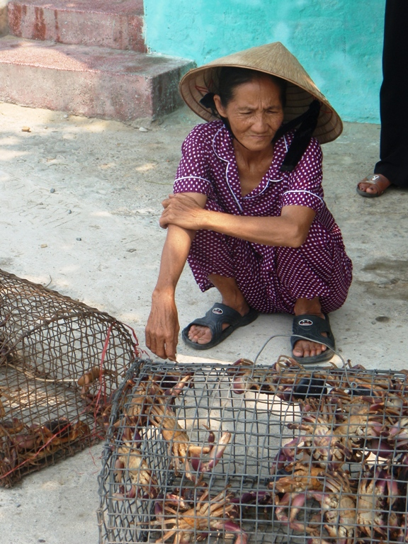 woman and crabs
