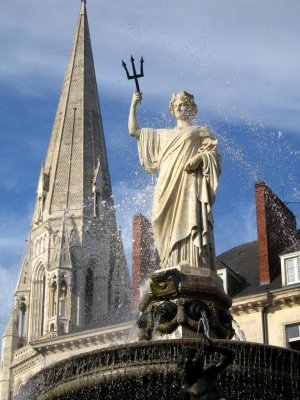 Fountain at Place Royale and the tower of St Nicholas