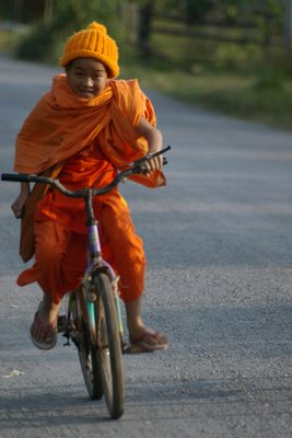 young monk on bicycle