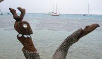 Wooden Tiki Man chasing fish