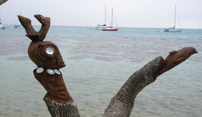 Wooden Tiki Man chasing fish