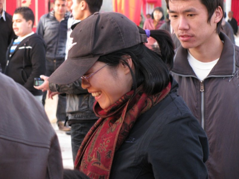 Happy Chinese woman in the crowd