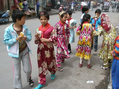 Children dressed for school... kaleidoscopic colours are favoured for Kashgari females.