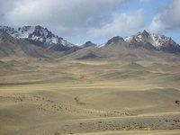 Mongolian landscape - snow capped mountains