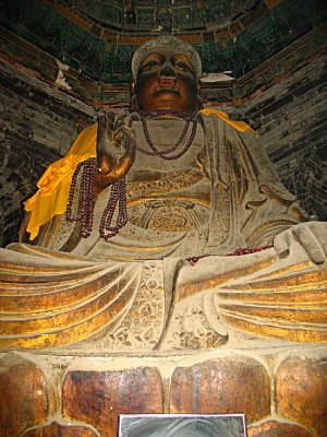 An ancient Buddha image on the second floor inside the middle of the structure