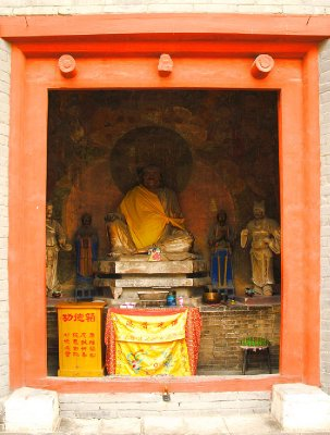 Orange accented Door and Buddha image
