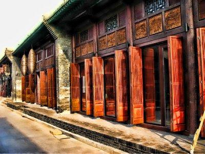 Lots of beautifully carved wooden Doors - Mao era