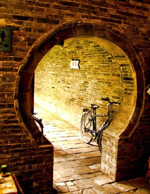 The bike in the door of a courtyard house