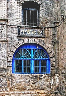 The dreaded Blue Window among the grayish bricks
