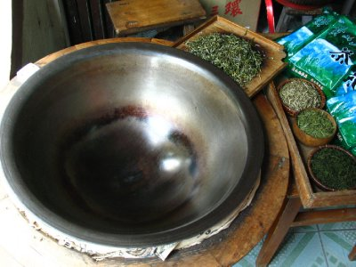 Cooking tea leaves from the local mountains