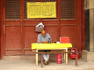 Working Seated Monk