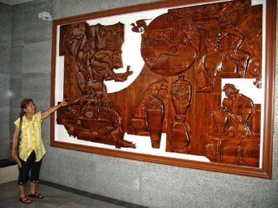 A huge carved Wood panel