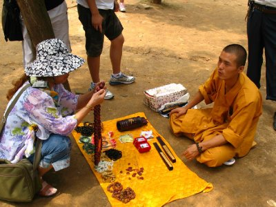 Shaolin monks hawking their wares