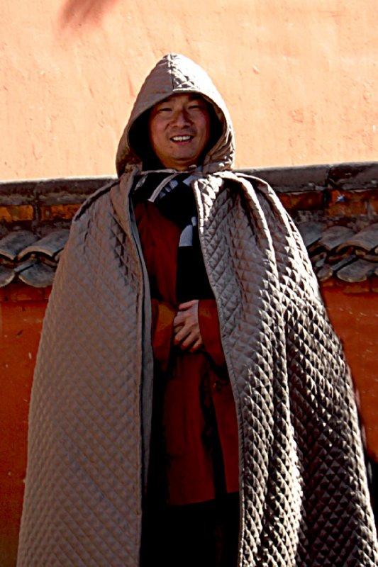 A friendly ticket taking monk