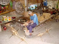 making umbrellas at the handcraft market in chiang mai