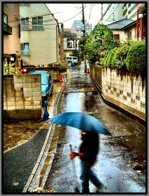 Jun sweeping the street during a rain pour 