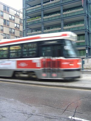 Streetcar zooms by, Toronto, Canada