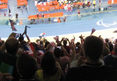Sarah Storey after her race, cycling past the crowds