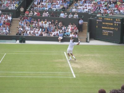 Del Porto Serving on Number 1 Court, The Championship, All England Lawn Tennis and Croquet Club, Wimbledon