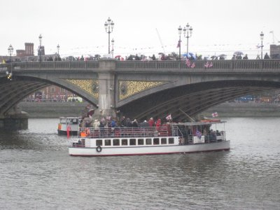 Flotilla passes under Battersea Bridge