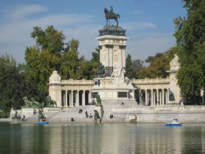 Monument to King Alfonso XII at lake in Parque de El Retiro
