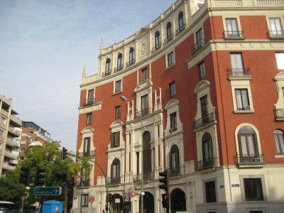 Red Curvy Building at Ruben Dario