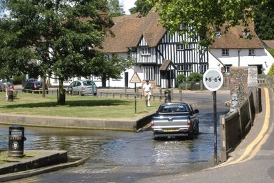 A car going through the Ford of the River Darent in Eynsford