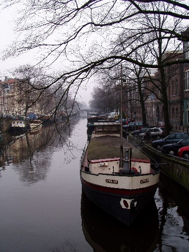 Canal with houseboat, Amsterdam, Netherlands