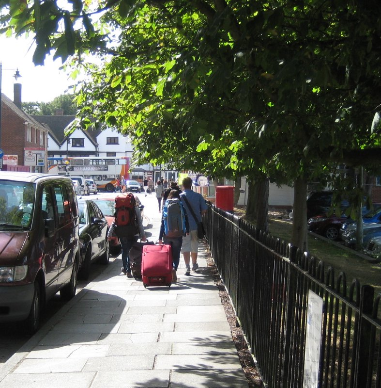 Backpackers, fresh off the train.  Canterbury, Kent, UK
