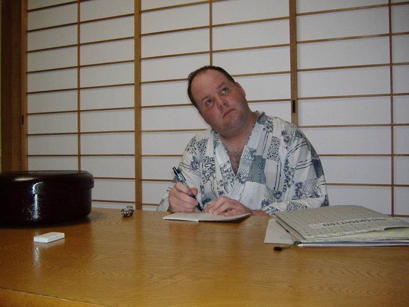 Me writing at my tiny table, Kyoto Japan