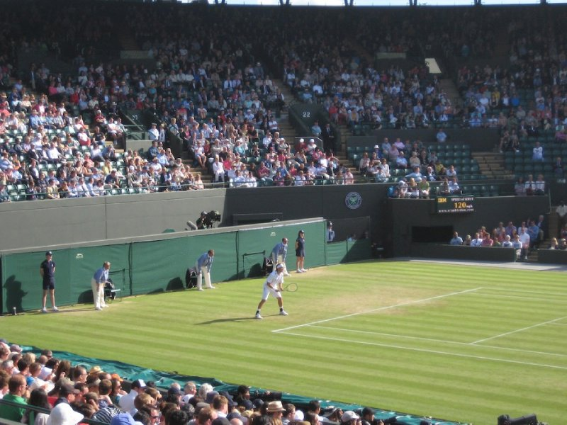 Lacko waiting for serve from Tsonga on Number 1 Court, The Championship, All England Lawn Tennis and Croquet Club, Wimbledon