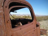 Looking out on the desert through the window of an old truck