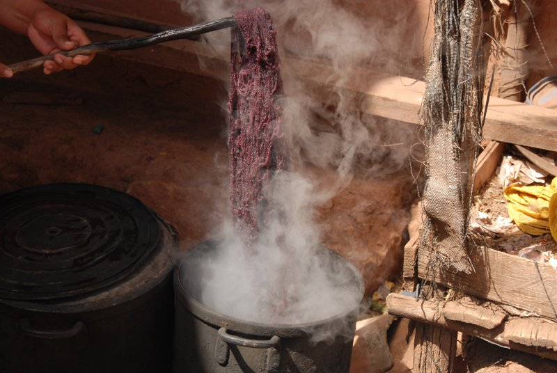 The purple llama wool being removed from the pot