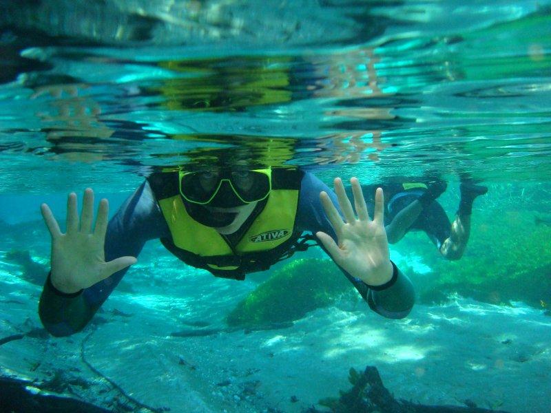 Lori waving underwater